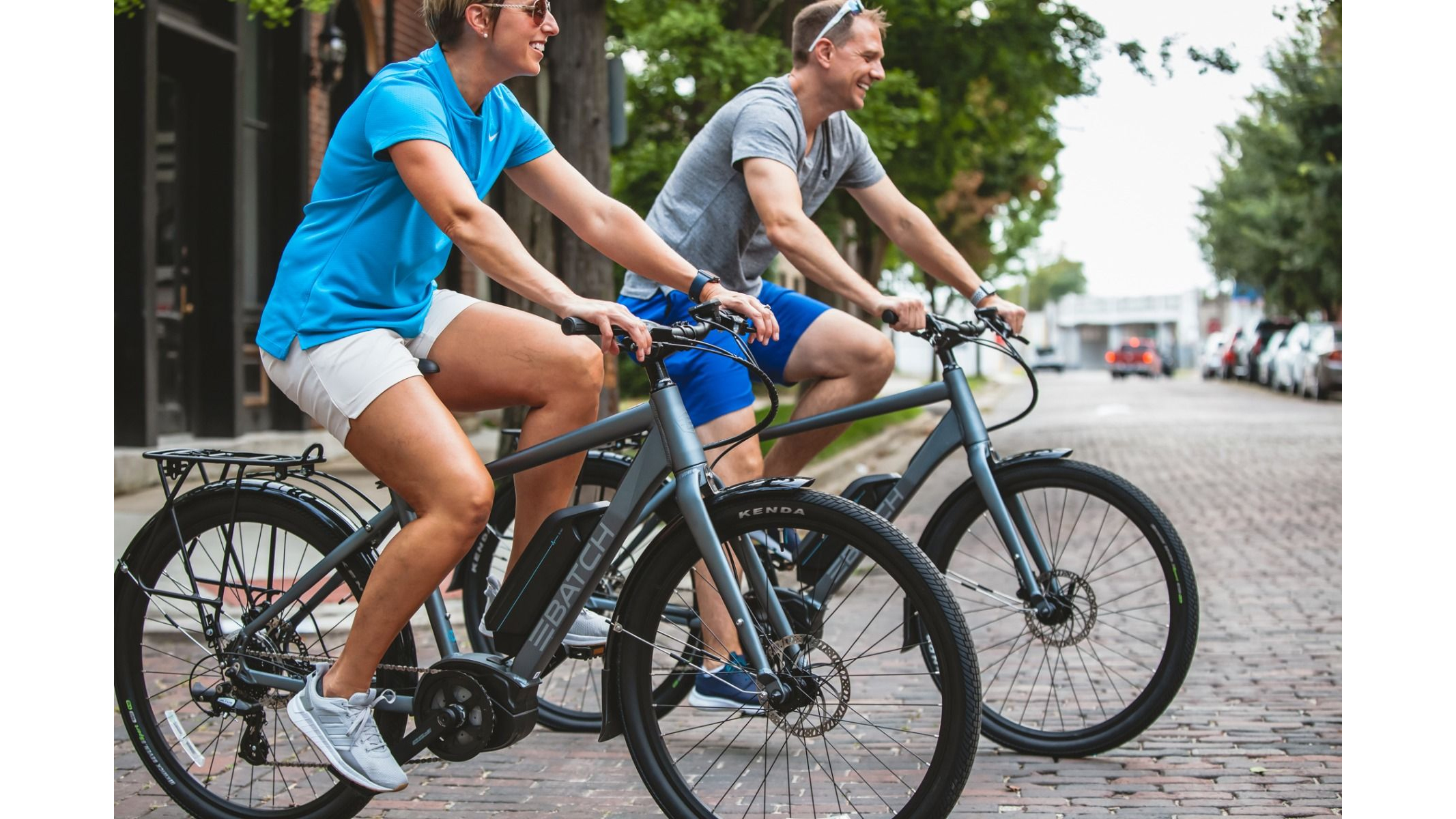 Two adults ride with Batch electric touring bike